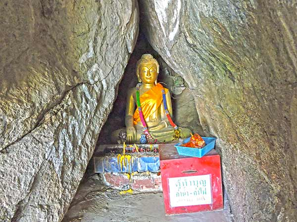 Small Buddha In A Cave